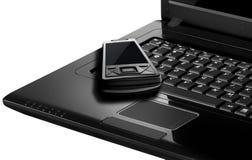 移动电话笔记本 免版税库存照片