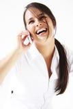 移动电话联系妇女年轻人 免版税库存图片