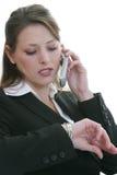 移动电话联系的妇女 免版税图库摄影