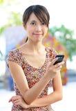 移动电话sms妇女 免版税图库摄影