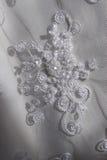 稀薄成串珠状刺绣织品白色 库存照片
