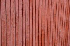 稀薄的篱芭红色明亮的木纹理上 库存图片