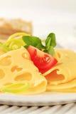 稀薄被切的瑞士乳酪 库存照片