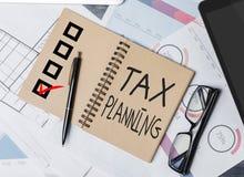 税务计划笔记薄 图库摄影