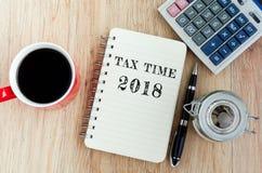 税在笔记薄的时间文本 免版税库存照片
