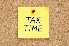 税时间稠粘的笔记 免版税库存照片