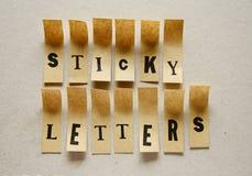 稠粘的信件-在稠粘的信件的词 免版税库存照片