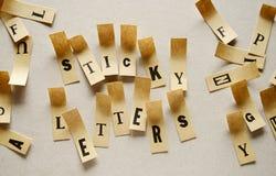 稠粘的信件-在稠粘的信件的词 免版税库存图片