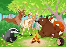 滑稽的动物在木头一起聚集 免版税库存照片