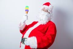 滑稽的圣诞老人用冰淇凌 库存照片