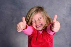 滑稽的女孩赞许 免版税库存图片
