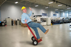 滑稽的工厂劳工,工作安全 免版税库存图片