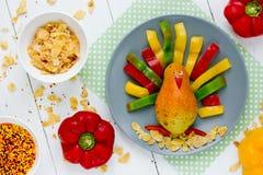 滑稽的梨五颜六色的胡椒感恩火鸡早晨早餐 免版税库存照片