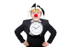 滑稽的概念的商人小丑被隔绝 库存照片