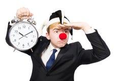 滑稽的概念的商人小丑被隔绝 库存图片