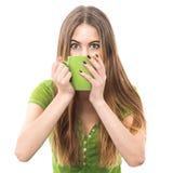 滑稽的激动的妇女饮用的咖啡和设法醒 库存图片