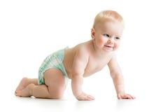 滑稽的爬行的男婴 免版税库存照片