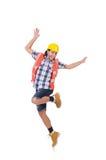 滑稽的跳舞年轻建筑工人被隔绝 免版税库存照片