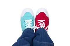 滑稽的运动鞋和牛仔裤 图库摄影