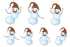 滑稽的雪人设置了与帽子和红萝卜鼻子跳舞 免版税库存照片