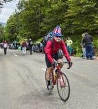 滑稽的非职业骑自行车者 库存照片