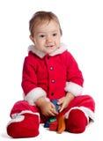 滑稽的婴孩在圣诞老人衣裳 库存图片
