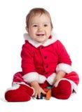 滑稽的婴孩在圣诞老人衣裳 库存照片