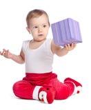 滑稽的婴孩在圣诞老人长裤 库存图片