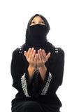 穆斯林祈祷妇女 免版税库存照片