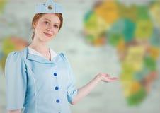 空中小姐与实施反对模糊的地图 免版税库存照片