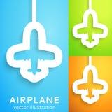 空中飞机删去了在颜色背景的纸。 库存照片