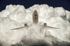 空中飞机和云彩 库存图片