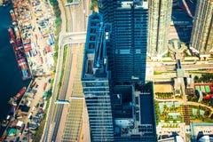 空中香港视图 与摩天大楼的未来派都市风景 免版税库存照片