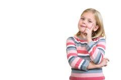 空想家一点 看快乐的小女孩握在下巴的手指和  库存图片
