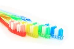空白五颜六色的四把查出的牙刷 库存图片