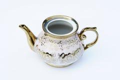 空白和开放金黄被设计的水壶 图库摄影