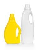 空白和黄色洗涤剂塑料瓶 库存照片