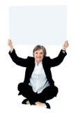 空白女实业家藏品供以座位的whiteboard 免版税图库摄影
