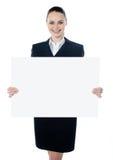空白女实业家藏品海报白色 免版税库存照片