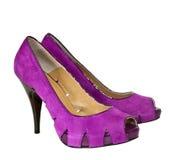 空白查出的紫色的鞋子 免版税库存图片