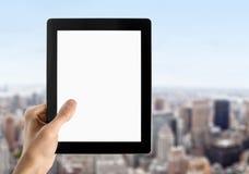 空白现有量拿着个人计算机片剂 免版税图库摄影