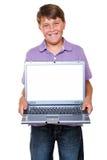 空白男孩膝上型计算机屏幕 库存照片