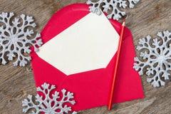 空白的信件和银色雪花 库存图片
