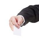 空白的名片正面图在男性手上 免版税库存图片