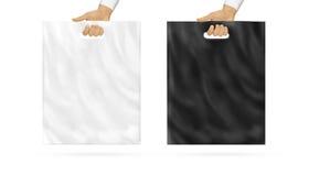 空白的塑料袋嘲笑设置了在手中举行 图库摄影