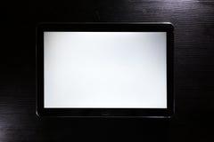 空白的片剂白色屏幕机器人黑时髦的公司木书桌 库存图片