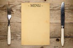 空白的菜单、叉子和刀子 库存照片