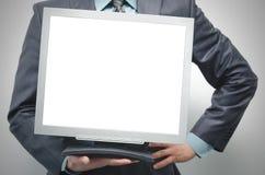 空白的计算机显示器在手上 库存图片