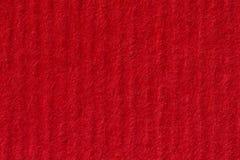 空白的织地不很细红色纸背景 库存照片