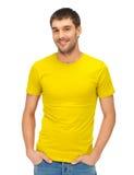 空白的黄色衬衣的英俊的人 免版税库存图片